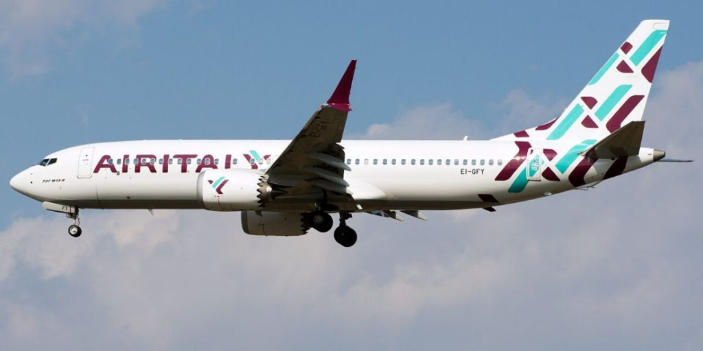 air italy plane above the clouds