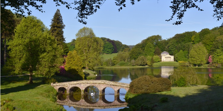 an image of a bridge crossing a lake at Stourhead, Wiltshire