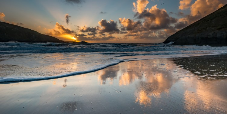 Sunset reflection on a beach in Mwnt