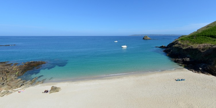 an image of an empty beach in Herm