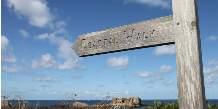 an image of the sign for the Coastal Path in Alderney