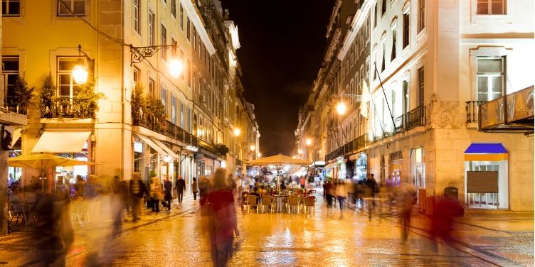 an image of Augusta Street in Lisbon, Portugal at night