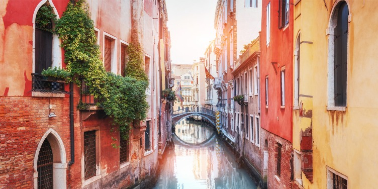 an image of a narrow canal in Venice, Italy