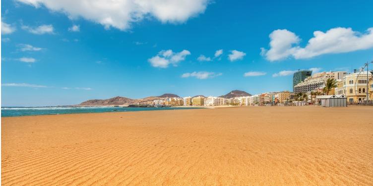 Empty golden beaches of Playa de Las Canteras beach in Gran Canaria
